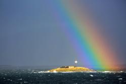 Regenbogen über der Insel
