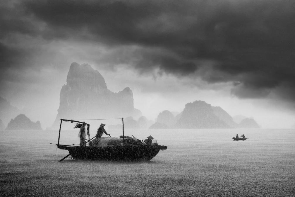 Fischer im Regen